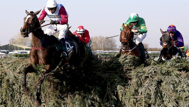 One For Arthur, ridden by jockey Derek Fox, jumps the last obstacle on the way to winning the Grand National horse race at the Aintree Racecourse, Liverpool, England, on Saturday April 8, 2017.