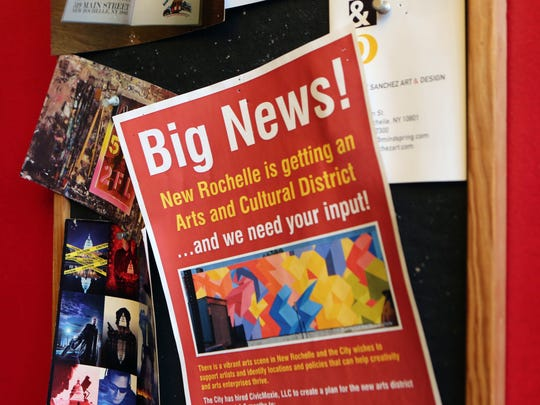 A flier announcing an Arts and Cultural District outside of artist Jesse Sanchez' studio on Main Street in New Rochelle.