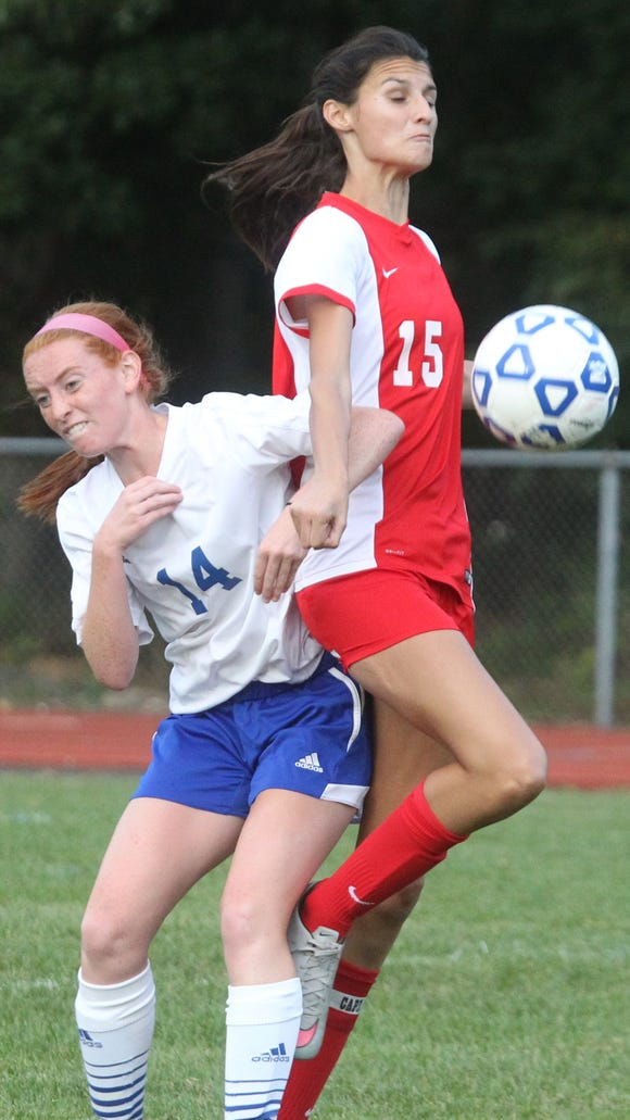 Pearl River's Tara Guilfoyle, left, pressures North Rockland's Arianna Marino during their game at Pearl River Sept. 21, 2015. Pearl River won 1-0.