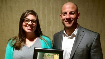 Milk Source's Environmental Coordinator Sarah Babcock and Human Resources Manager Ryan Knorr celebrate winning the 2016 Top Rural Development Initiatives award.