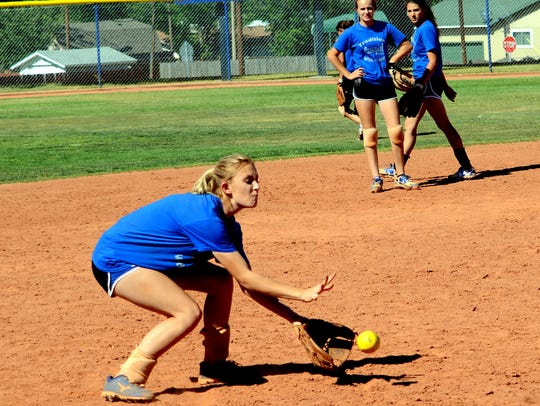 Carlsbad's Mikki Yerby scoops up a ground ball during