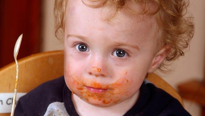 Wesley Balsamo, 14 months, St. Louis, eats Beech-Nut Let's Grow! Spaghetti Rings Mini Meal.