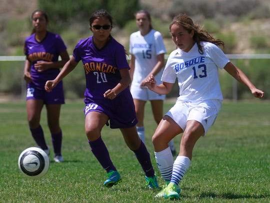 Kirtland Central's Kalieyah Boyd, left, and Bosque's Bryanna Bravo chase the ball on Friday during the Aztec Invitational at the Aztec Tiger Sports Complex.
