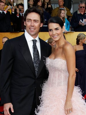 Angie Harmon and Jason Sehorn arrives at the  Screen Actors Guild Awards in 2011.