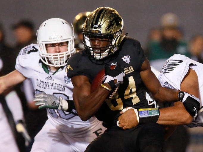 Western Michigan's Corey Davis is tackled by Eastern