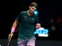 Rafael Nadal of Spain celebrates winning a point against Stefanos Tsitsipas of Greece during their tennis match at the ATP World Finals tennis tournament at the O2 arena in London, Thursday, Nov. 19, 2020. (AP Photo/Frank Augstein)