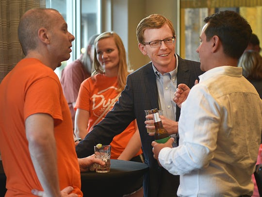 U.S. House Candidate Dusty Johnson talks to supporters