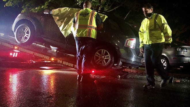 A Ford Edge SUV that was involved in an accident and a shooting Tuesday night near Kennnedy Park is towed from the scene. It was taken to the police department for processing.