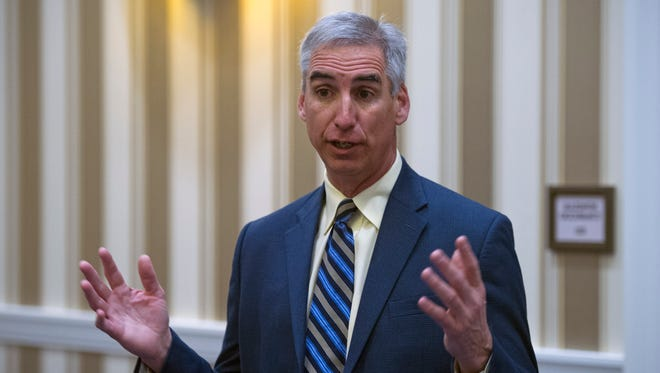 Oliver Luck speaks with members of the media Jan. 16, 2015.
