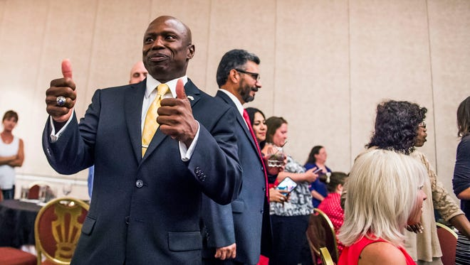 El Paso County Commissioner Darryl Glenn gives two thumbs during the U.S. Senate Republican Primary, Tuesday, June 28, 2016  in Colorado Springs, Colo. El Paso County Commissioner Darryl Glenn has won Colorado's Republican U.S. Senate primary and will face incumbent Democrat Michael Bennet in November.