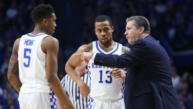 Kentucky Wildcats head coach John Calipari talks with Malik Monk and Isaiah Briscoe against the Arkansas Razorbacks during the second half at Rupp Arena in Lexington, Kentucky on Saturday, January 7, 2017.