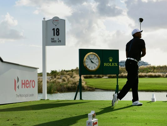 Tiger Woods drives from the tee of hole 18 during the Hero World Challenge golf tournament at Albany Golf Club in Nassau, Bahamas, Thursday, Nov. 30, 2017. (AP Photo/Dante Carrer)