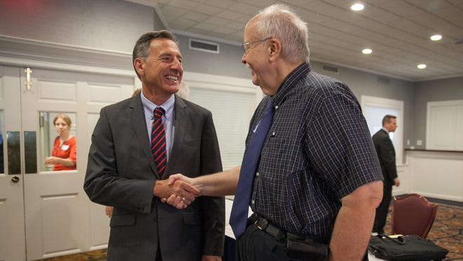 Gov. Peter Shumlin speaks with Free Press reporter Mike Donoghue, Thursday morning at the Capitol Plaza Hotel in Montpelier, where Donoghue received the Matthew Lyon First Amendment Award from the Vermont Press Association.