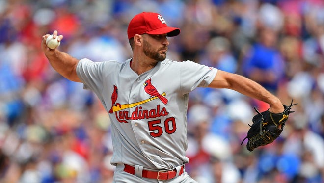 Cardinals starter Adam Wainwright throws a pitch against the Cubs at Wrigley Field in Chicago on July 22.