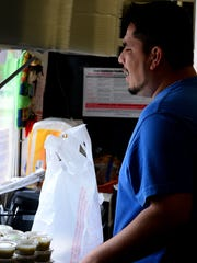 Francisco Gutierrez, co-owner of Pancho's Taqueria, talks with a customer Thursday, June 9, 2016 in Grand Ledge.
