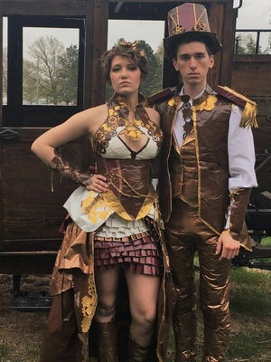Rozlin Opolka and Conner Hawry, both of Gregory, crafted these outfits out of duct tape for her senior prom at Fowlerville High School.