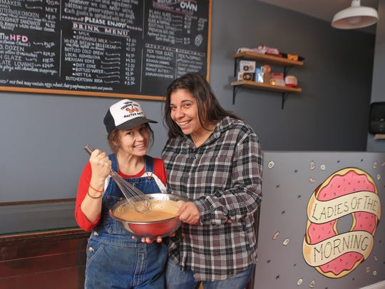 Hi-Five Doughnut owners Leslie Wilson, left, and Annie Harlow have brought their popular, food truck-only handmade doughnuts to a permanent storefront on Main Street in Butchertown.