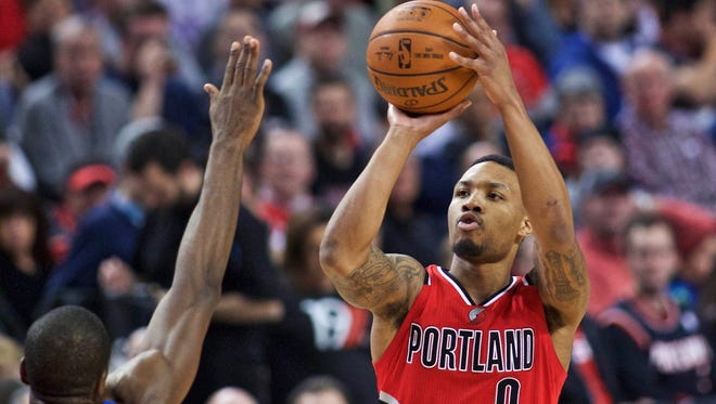 Portland Trail Blazers guard Damian Lillard shoots over Oklahoma City Thunder forward Serge Ibaka during the second half of an NBA basketball game in Portland, Ore. At the All-Star break, the Blazers are at .500 (27-27) and surprisingly sit in seventh place in the standings. Lillard, the fourth-year point guard is averaging 24.3 points and 7.3 assists per games, and is the only player that ranks in the league's top six in both categories. (AP Photo/Craig Mitchelldyer, File)
