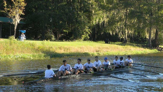 Members of the Sebastian River High School Sharks crew launch Oct. 22, 2016, during the Gator Head Regatta on Newnans Lake in Gainesville.