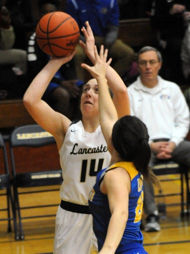 Lancaster's Savannah Dryden takes a shot Friday night,