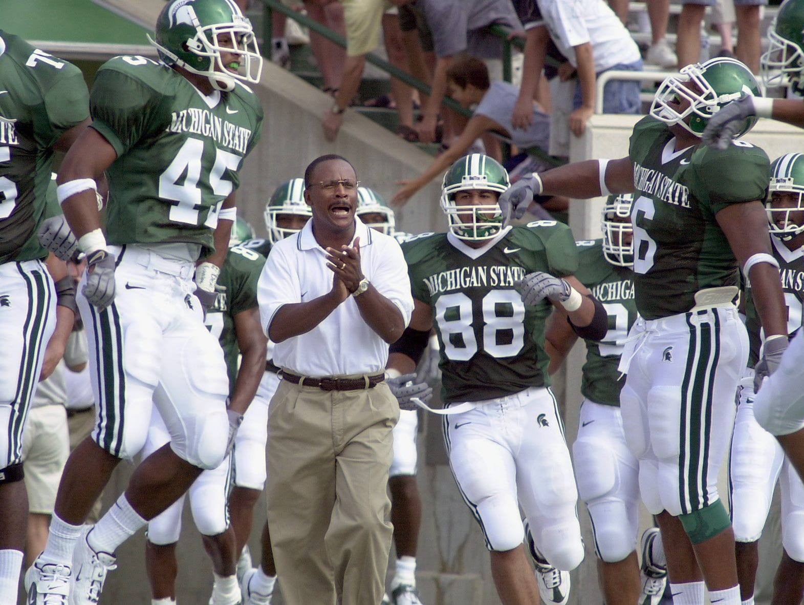- MSU head football coach Bobby Williams, center, leads his team onto the field at Spartan Stadium against Marshall for his first home game as head coach.