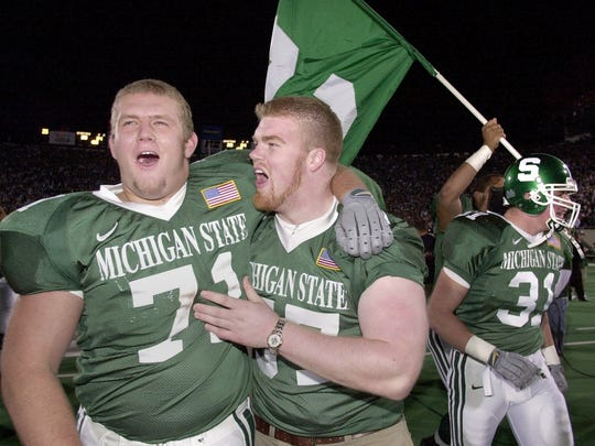 MSU players including Gordon Niebylski, left, celebrate
