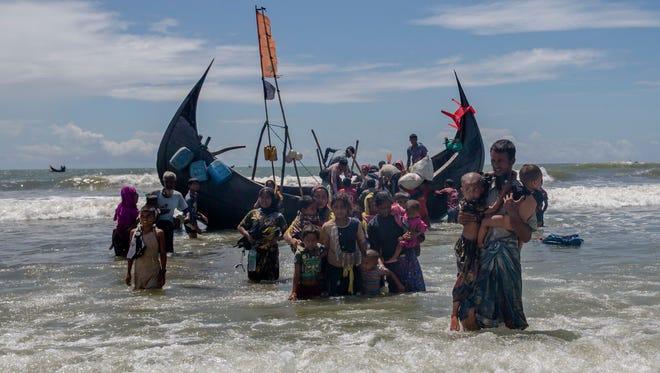 Rohingya refugees arrive in Shah Porir Dwip, Bangladesh, in 2017.