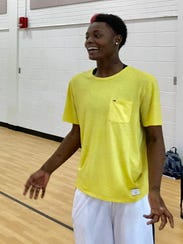 Dunbar's Ja'miah Bland laughs with teammates after