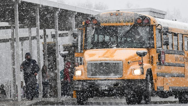 Walhalla High School get on the bus as school ended early on Friday.