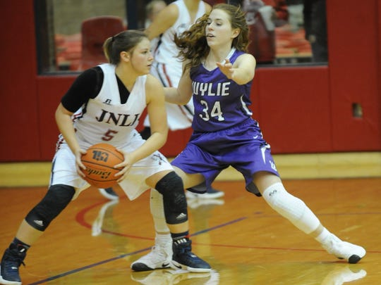 Wylie's Julia Lovelace (34) defends against Jim Ned's Ryan Bush. Wylie beat the Lady Indians 47-40 in the nondistrict game Monday, Dec. 19, 2016 at Bill Thornton Arena in Tuscola.