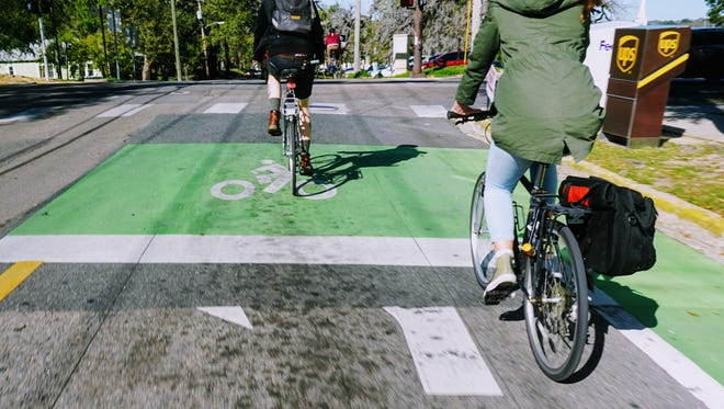 Bicycle boxes provide priority for cyclists to go in front of cars and have better accessibility turning left.