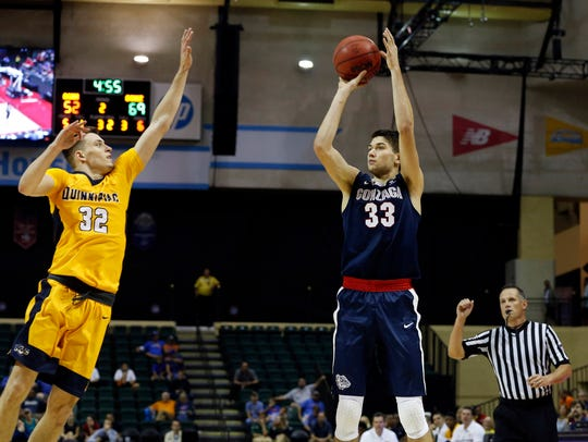 Peter Kiss, left, defends a shot against Gonzaga in