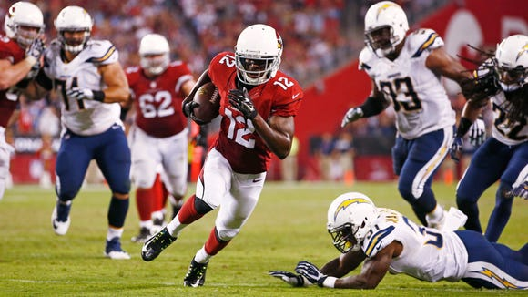 Arizona Cardinals rookie wide receiver John Brown catches a 13-yard game winning touchdown and first NFL TD against San Diego Chargers in the second half during Monday Night Football on Sep. 8, 2014 at University of Phoenix Stadium in Glendale, AZ. (Photo by Rob Schumacher/Arizona Republic)