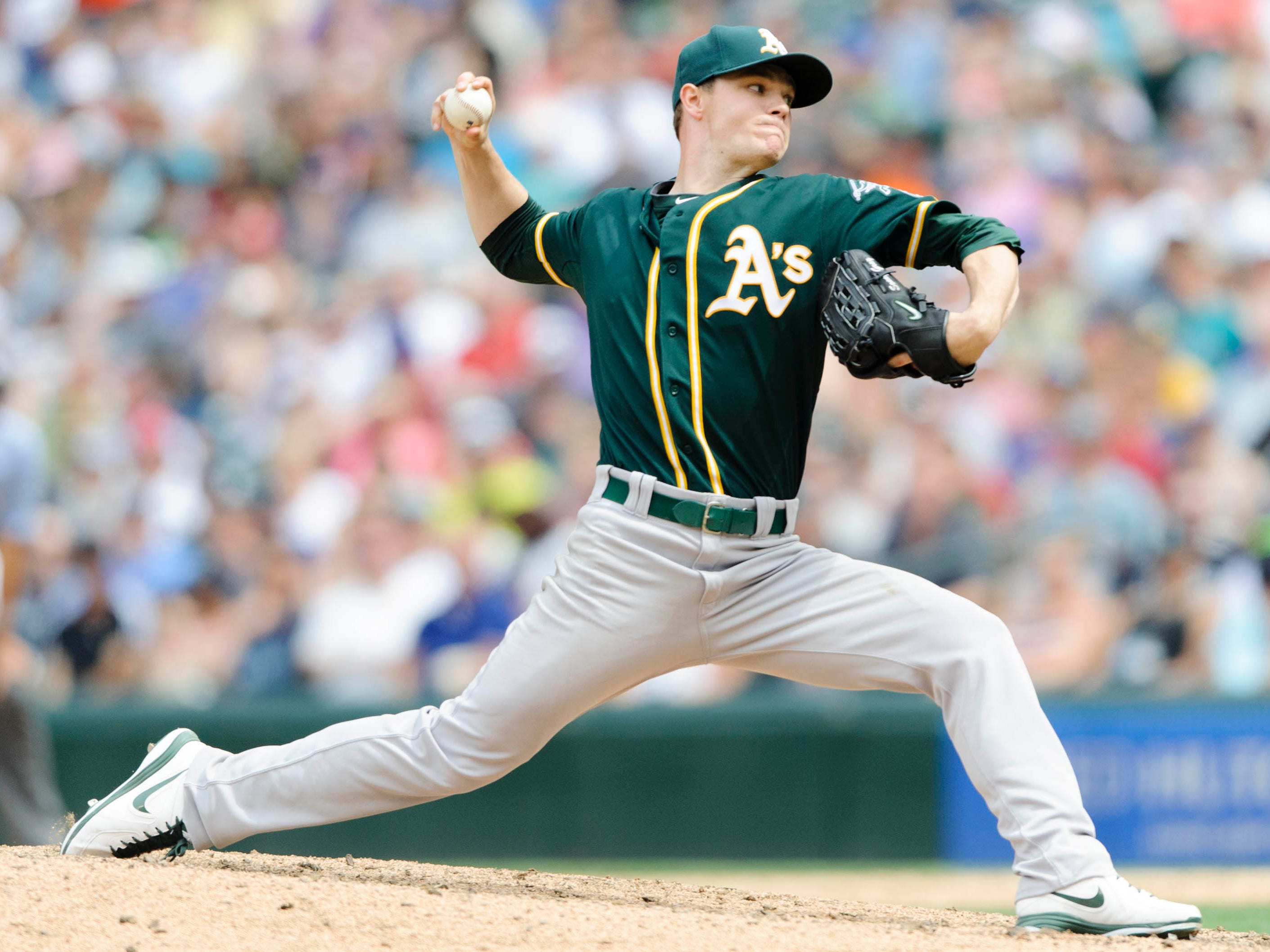 Jul 13, 2014; Seattle, WA, USA; Oakland Athletics starting pitcher Sonny Gray (54) pitches to the Seattle Mariners during the eighth inning at Safeco Field. Mandatory Credit: Steven Bisig-USA TODAY Sports