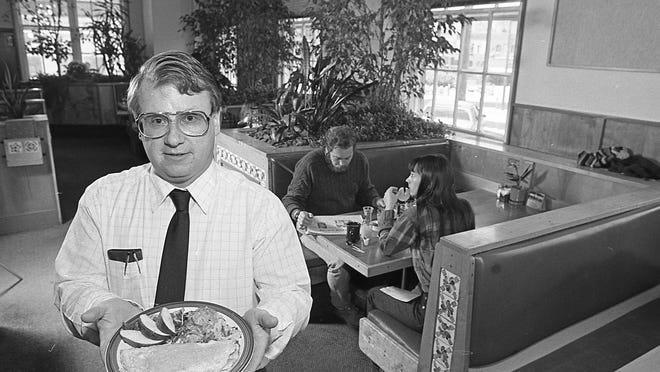 PanTree Restaurant general manager Ron Hummel holds one of the many variations of legendary omelets the restaurant served, in 1987. The restaurant was located at 327 Abbott Road, East Lansing.