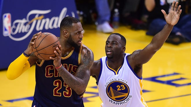 LeBron James, left, and the Cavaliers will look to win their second title in three seasons against Draymond Green and the  Warriors.