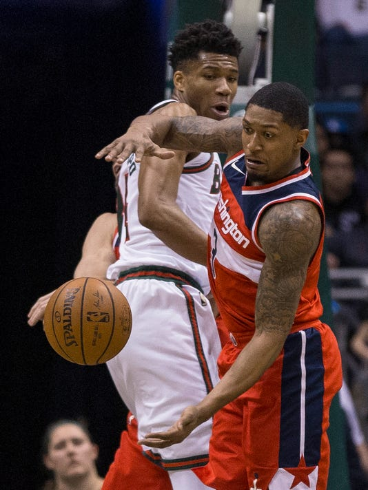 Milwaukee Bucks' Giannis Antetokounmpo, left, and Washington Wizards' Bradley Beal look for a rebound during the first half of an NBA basketball game Tuesday, Feb. 27, 2018, in Milwaukee. (AP Photo/Tom Lynn)
