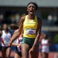 Jun 13, 2015; Eugene, OR, USA; Raevyn Rogers of Oregon celebrates after winning the women's 800m in 1:59.71 in the 2015 NCAA Track & Field Championships at Hayward Field. Mandatory Credit: Kirby Lee-USA TODAY Sports