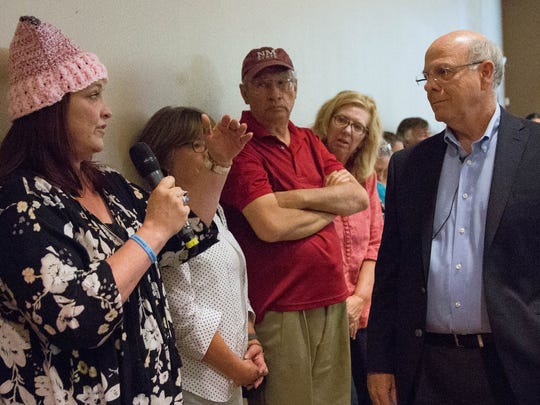 Cristan Biadismond,left, invited US Representative Steve Pearce to meet with some of her patients who would be effected by the building of the wall. Pearce said his staff would try and set something up. Saturday March 18, 2017, at the New Mexico Farm and Ranch Heritage Museum.