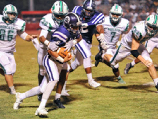 Dashawn Vigers makes the tackle on Christian Comeaux