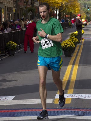 Ben Clarke, of Morristown, NJ, finishes fourth in the Wineglass Marathon Sunday.