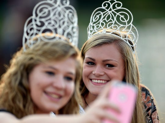 Miss Henderson County Kaci Givens, left, takes a selfie along with Miss Teen Henderson County Hannah Watkins before being introduced at the rodeo during the Henderson County Fair in 2016. Last year was the first time in 27 years the rodeo was featured during the fair.