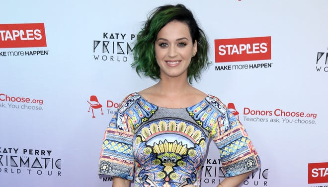 """Katy Perry attends the """"Make Roar Happen"""" news conference in Los Angeles."""