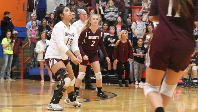 Bronte High School's Sadie Delacerda (13) and teammate Jayden Speary (2) watch for the ball as Delacerda prepare to pass during the Region I-1A volleyball tournament Saturday, Nov. 11, 2017, at Babe Didrikson Gym at Central High School.