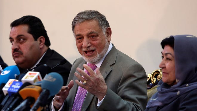 Ahmad Yousuf Nouristani, chairman of the Independent Election Commission, center, speaks during a press conference in Kabul, Afghanistan, on Sunday.