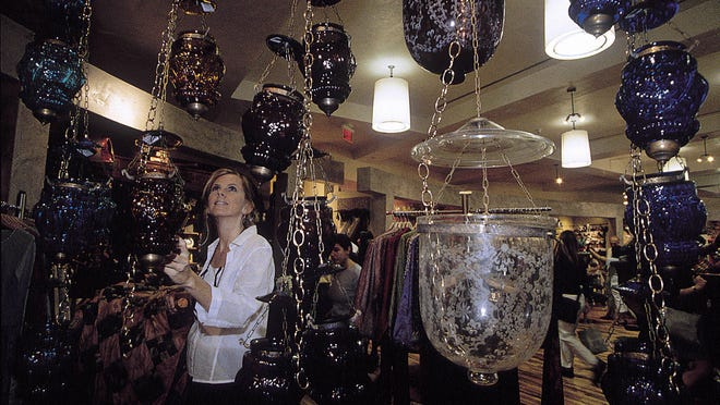 A shopper examines the merchandise at Anthropologie in West Palm Beach.