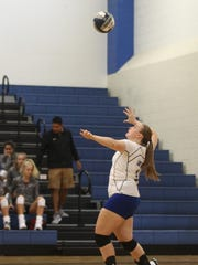 Lake View's Taylor Spencer serves against Sterling