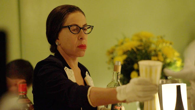 Mamacita (Jackie Hoffman) is there to anticipate Joan Crawford's every need, including alcohol, in FX's 'Feud: Bette and Joan.'