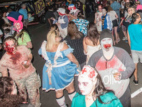 Downtown Montgomery's streets were filled with the living dead on Friday, Sept. 30, 2016, for the Zombie Walk & Prom VI.