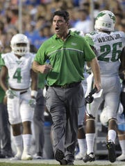 North Texas coach Seth Littrell, center, reacts after